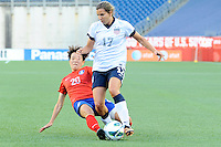 Korea Republic defender Kim Hyeri (20) and US Womens National midfielder Tobin Heath (17) in action during the International Friendly soccer match between the USA Women's National team and the Korea Republic Women's Team held at Gillette Stadium in Foxborough Massachusetts.   Eric Canha/CSM