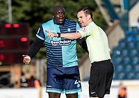 Animated Adebayo Akinfenwa of Wycombe Wanderers with Referee Ross Joyce during the Sky Bet League 2 match between Wycombe Wanderers and Notts County at Adams Park, High Wycombe, England on the 25th March 2017. Photo by Liam McAvoy.