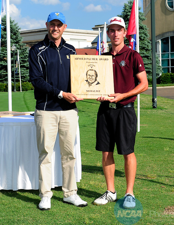 16 MAY 2014:  Bobby Holden of the University of Redlands, right, is presented the Arnold Palmer Award for overall lowest score following the Division III Men's Golf Championship held at the Grandover Resort in Greensboro, NC.  Holden shot a 70 for the final round and 279 overall.  Jeffrey Camarati/NCAA Photos