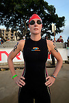 KAILUA-KONA, HI - OCTOBER 12:  Leanda Cave stretches before the swim start during the 2013 Ironman World Championship on October 12, 2013 in Kailua-Kona, Hawaii. (Photo by Donald Miralle) *** Local Caption ***