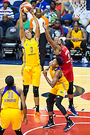 Washington, DC - July 22, 2016: Los Angeles Sparks forward Candace Parker (3) brings down a rebound over Washington Mystics center Kia Vaughn (9) during their match up at the Verizon Center in Washington, DC. (Photo by Phil Peters/Media Images International)