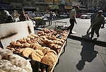 Palestinian vendor sells bread on the eighth day of the holy month of Ramadan in the West Bank city of Ramallah on August 18. 2010. Photo by Eyad Jadallah