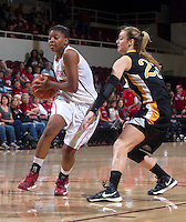 Stanford's Amber Orrange drive the ball past Long Beach States's Mary Ochiltree during Saturday, November 25, 2012 game at Stanford against Long Beach State.. Stanford won 77-41.