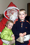 Nikita and Jason Kerr, Ferdia Park with Santa in the Ardee Day Care Centre..Picture: Paul Mohan/Newsfile