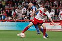 Greg Tansey of Stevenage holds off Matt Richards of Shrewsbury.  Stevenage v Shrewsbury Town - npower League 1 -  Lamex Stadium, Stevenage - 1st September, 2012. © Kevin Coleman 2012.