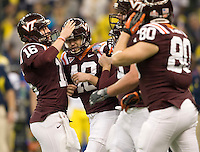 Justin Myer of Virginia Tech celebrates with his teammates after Myer scored a field goal during Sugar Bowl game at Mercedes-Benz SuperDome in New Orleans, Louisiana on January 3rd, 2012.    Michigan defeated Virginia Tech, 23-20 in first overtime.