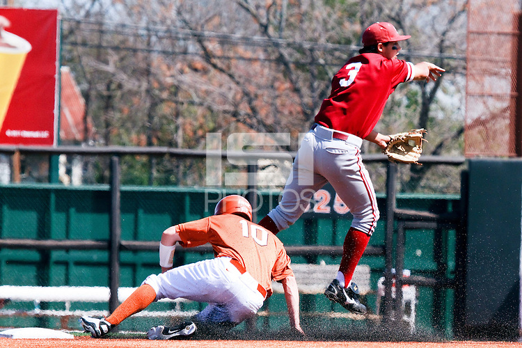 AUSTIN, TEXAS-March 6, 2011:  Kenny Diekroeger of Stanford avoids a runner trying to break up a double play during the game against the Texas Longhorns, at Disch-Falk field in Austin, Texas.  Texas defeated Stanford 4-2.