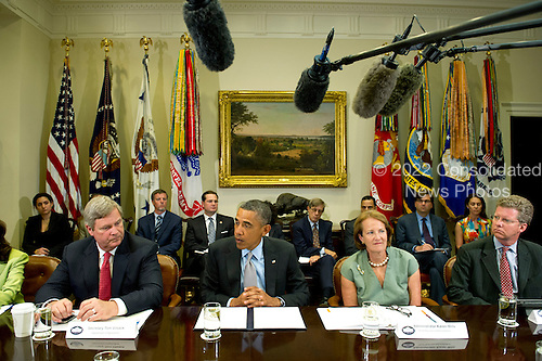 United States President Barack Obama delivers remarks to the media after meeting with the White House Rural Council to discuss ongoing efforts in response to the drought in the Roosevelt Room at the White House on August 7, 2012 in Washington, DC. Obama was joined, from left to right, by U.S. Secretary of Agriculture Tom Vilsack,  Small Business Administration (SBA) Administrator Karen Mills, and HUD Secretary of Housing and Urban Development (HUD) Shawn Donovan. .Credit: Kevin Dietsch / Pool via CNP