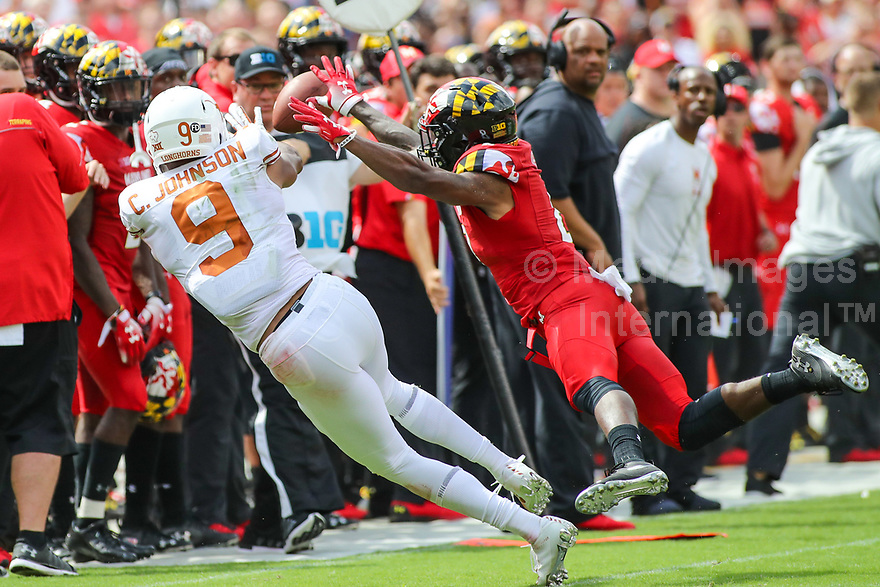 Landover, MD - September 1, 2018: Maryland Terrapins defender breaks up a pass to Texas Longhorns wide receiver Collin Johnson (9) during the game between Texas and Maryland at  FedEx Field in Landover, MD.  (Photo by Elliott Brown/Media Images International)