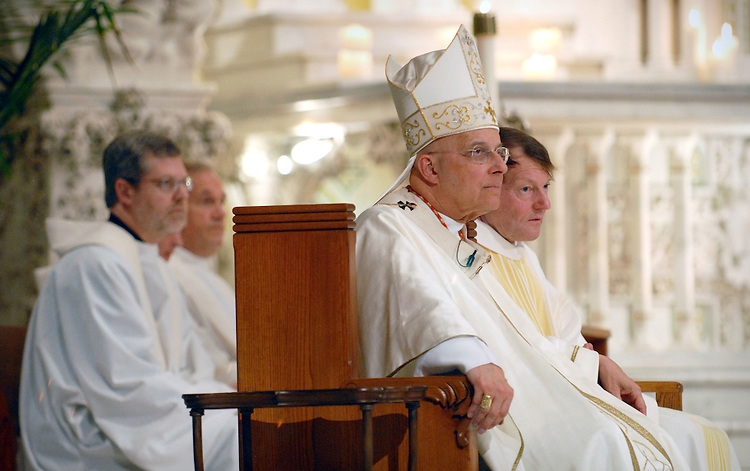 FILE PHOTOS: Francis Cardinal George, O.M.I., Archbishop of Chicago, celebrates Mass for DePaul University students in April 2008 at the St. Vincent de Paul Parish. (Photo by David Kamba)