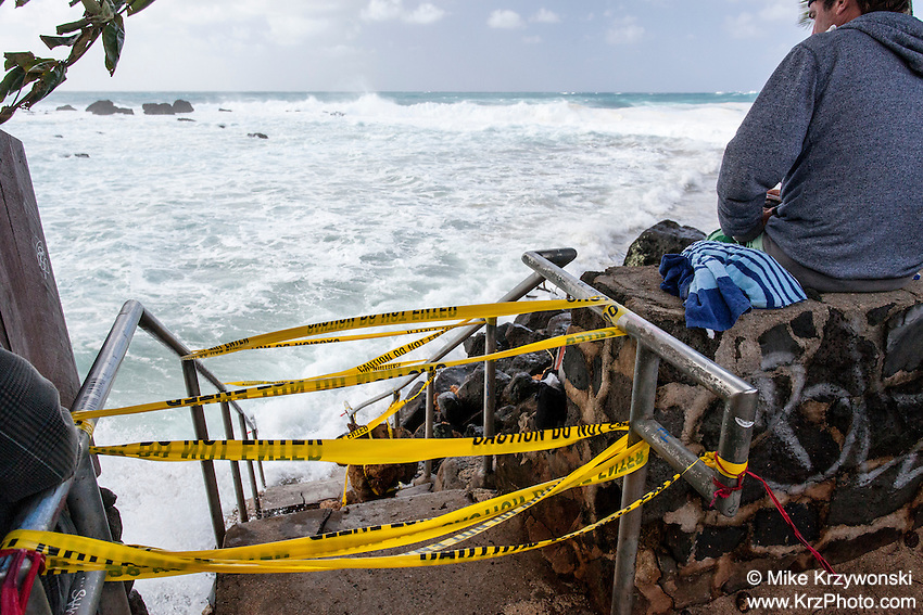 Waves crashing over public beach access stairs during the giant swell of Jan. 22, 2014 at Keiki Beach, North Shore, Oahu