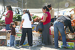 PEOPLE BUY FRUITS AND VEGGIES AT WEEKLY FLEA MARKET