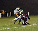 Brad Gillham of Stotfold saves from Richard Bunting of Long Buckby  during the FA Carlsberg Vase 3rd round  match between Stotfold and Long Buckby at Roker Park, Stotfold on 4th December, 2010.© Kevin Coleman 2010.