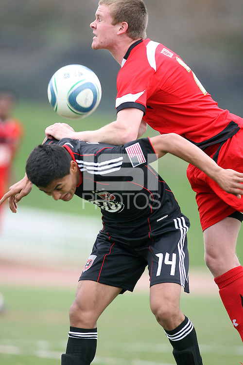 Andy Najar (14) of D.C. United tackled by Helge Leikvang (6)  during a scrimmage against the University of Maryland at Ludwig Field, University of Maryland, College Park, on April  10 2011. D.C. United won 1-0.