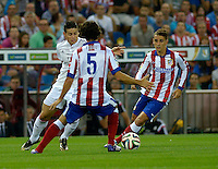 MADRID - ESPAÑA - 22-08-2014: Tiago (Der.) jugador de Atletico de Madrid disputa el balon con James Rodriguez (Izq.) jugador de Real Madrid durante partido de vuelta de la Super Copa de España, Atletico de Madrid  y Real Madrid, en el estadio Vicente Calderon de la ciudad de Madrid, España. / Tiago (R) player of Atletico de Madrid  vies for the ball with James Rodriguez ( (L) player of Real Madrid during a match for the second leg, between Atletico de Madrid  y Real Madrid of the Super Copa de España in the Vicente Calderon stadium in Madrid, Spain  Photo: Asnerp / Patricio Realpe / VizzorImage.