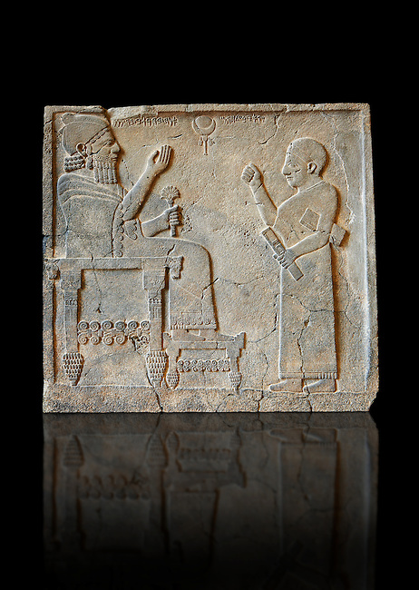 """Relief panels orthostat from northern part of the hall at the Palace of Sam 'al - Zincirli. On the throne sits the Prince Barrakib, before him stands a scribe with his pen with a writing board under his arm. Above their heads each side of a crescent moon  are inscriptions in Aramaic """"I am Barrakib, son of Panammuwa"""" and the inscription """"My Lord of the Ba 'al of Harran"""" with symbols of the moon god.Neo Syro Hittite.  Basalt around 730 BC. Neo Syro Hittite.  Basalt around 730 BC.  Pergamon Museum, Berlin, inv no VA2817"""