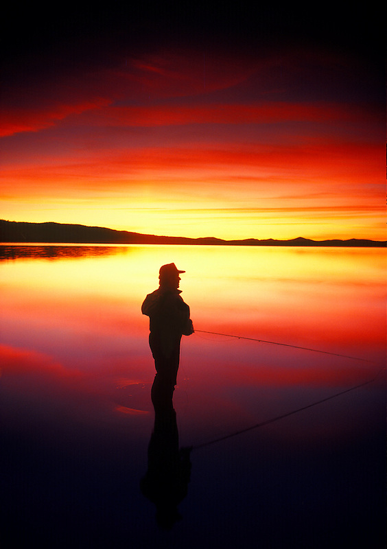 Fly fisherman on Chickahominy Reservoir. Oregon.