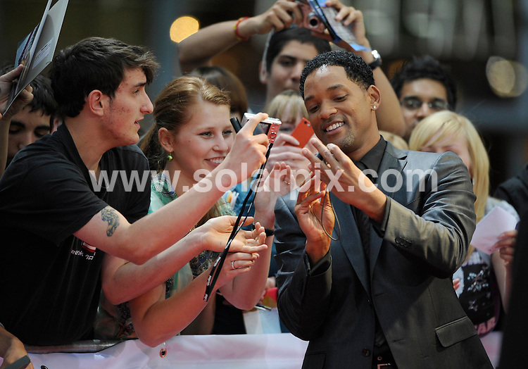 **ALL ROUND PICTURES FROM SOLARPIX.COM**.**SYNDICATION RIGHTS FOR UK AND SPAIN ONLY**.The Hollywood Actor Will Smith and actress Charlize Theron at the red carpet  premiere of his movie Hancock at the Sony center in Berlin in Germany..This pic:will Smith.JOB REF: 6666-CPR/Michael Gottschalk  DATE:17-06_08.**MUST CREDIT SOLARPIX.COM OR DOUBLE FEE WILL BE CHARGED* *UNDER NO CIRCUMSTANCES IS THIS IMAGE TO BE REPRODUCED FOR ANY ONLINE EDITION WITHOUT PRIOR PERMISSION*