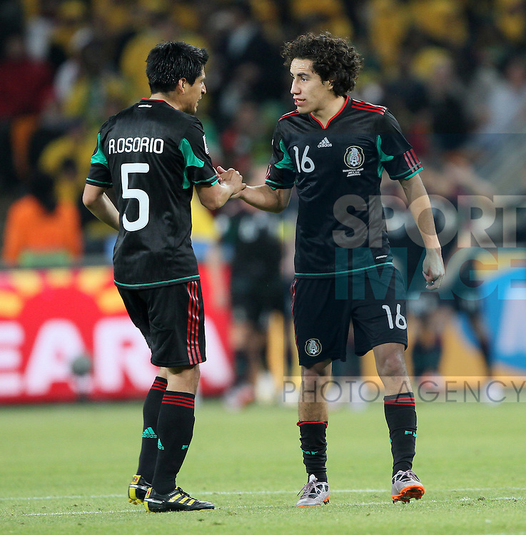 Mexico's Ricardo Osorio celebrates his sides goal with Efrain Juarez
