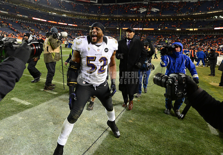 Jan 12, 2013; Denver, CO, USA; Baltimore Ravens linebacker Ray Lewis (52) celebrates following the game against the Denver Broncos during the AFC divisional round playoff game at Sports Authority Field.  The Ravens defeated the Broncos 38-35 in double overtime. Mandatory Credit: Mark J. Rebilas-