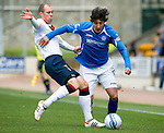 St Johnstone v Rangers....13.05.12   SPL.Fran Sandaza tackled by Stephen Whittaker.Picture by Graeme Hart..Copyright Perthshire Picture Agency.Tel: 01738 623350  Mobile: 07990 594431