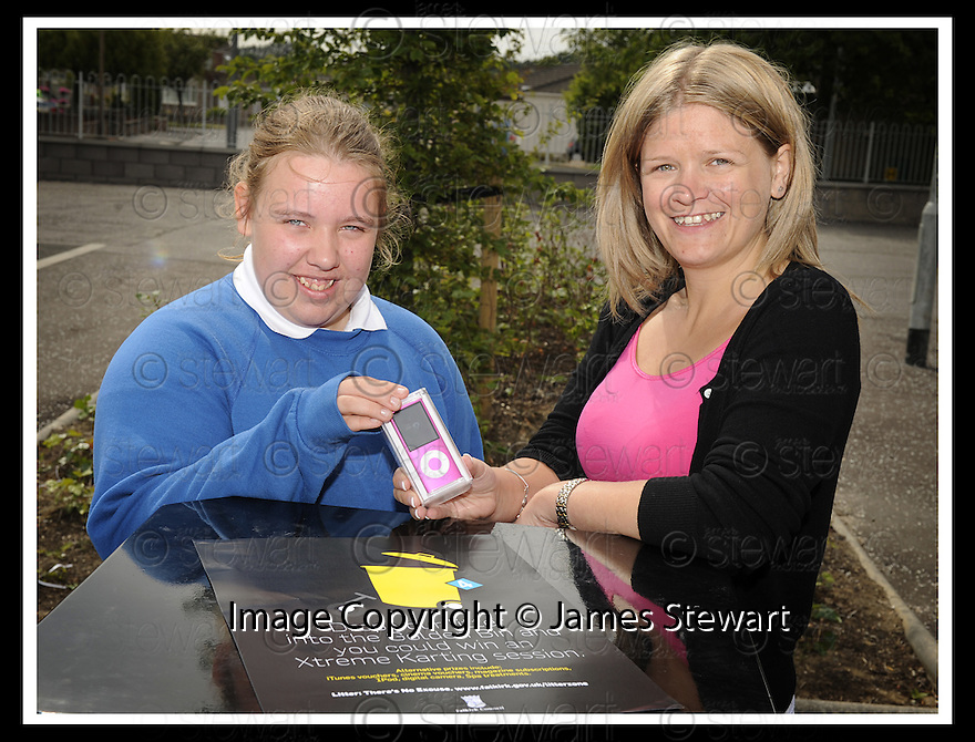 25/06/2009  Copyright  Pic : James Stewart.05_golden_bin  .::  GOLDEN BIN WINNER LAREN JARVIE, 2ND YEAR, GRANGEMOUTH HIGH SCHOOL, RECEIVES HER  HER IPOD PRIZE FROM JENNIFER TERRIS FROM FALKIRK COUNCIL'S LITTER STRATEGY TEAM:: .James Stewart Photography 19 Carronlea Drive, Falkirk. FK2 8DN      Vat Reg No. 607 6932 25.Telephone      : +44 (0)1324 570291 .Mobile              : +44 (0)7721 416997.E-mail  :  jim@jspa.co.uk.If you require further information then contact Jim Stewart on any of the numbers above.........