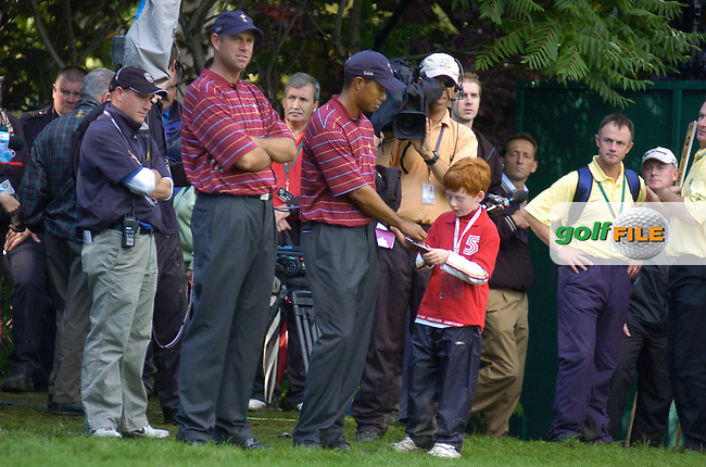 24th September, 2006. American Ryder Cup Team player Tiger Woods signs an autograph on the 16th green during the singles final session of the last day of the 2006 Ryder Cup at the K Club in Straffan, County Kildare in the Republic of Ireland..Photo: Barry Cronin/ Newsfile.