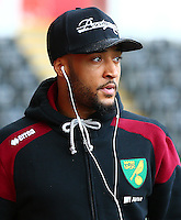 Nathan Redmond of Norwich City wearing Apple earphones during the Barclays Premier League match between Swansea City and Norwich City played at The Liberty Stadium, Swansea on March 5th 2016