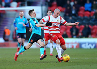 Ashley Hunter of Fleetwood Town battles for the ball against Luke McCullough of Doncaster Rovers during the Sky Bet League 1 match between Doncaster Rovers and Fleetwood Town at the Keepmoat Stadium, Doncaster, England on 17 February 2018. Photo by Leila Coker / PRiME Media Images.