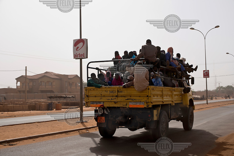 A lorry leaves the capital Niamey loaded with travellers heading north.