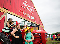 BALTIMORE, MD - MAY 20: A group of women pose at the Budweiser Country Club in the infield on Preakness Stakes Day at Pimlico Race Course on May 20, 2017 in Baltimore, Maryland.(Photo by Scott Serio/Eclipse Sportswire/Getty Images)