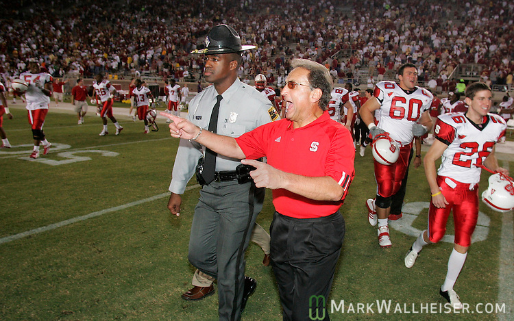 North Carolina State head coach Chuck Amato (R) celebrates with his team as they run out onto the field after defeating Florida State 20-15 in Tallahassee, Florida November 5, 2005.  Coach Amato was the defensive coordinator for .Florida State before becoming head coach of the NC State Wolfpack.