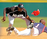 14 March 2006: Frank Moore, infielder for the Florida Marlins, fails to tag out the sliding Tyrell Godwin during a Spring Training game against the Washington Nationals. The Marlins defeated the Nationals 2-1 at Space Coast Stadium, in Viera, Florida...Mandatory Photo Credit: Ed Wolfstein..
