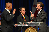 January 2, 2013  (Washington, DC)  Newly elected D.C. Council member David Grosso (I-At Large) (right) is sworn-in during a ceremony at the Washington Convention Center, January 3, 2013.  (Photo by Don Baxter/Media Images International)