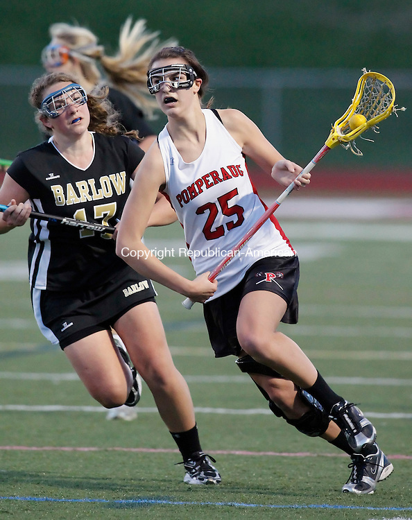 Southbury, CT-14, April 2010-041410CM06 Pomperaug's Laureen Baronowski (#25) carries the ball past Barlow defender, Lexi Churchill Wednesday night in Southbury.  The Pomperaug girl's lacrosse teamed improved to 3-0 after defeating Barlow, 14-12.  Their next game is this Friday against Immaculate of Danbury.       --Christopher Massa Republican-American