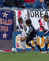 New England Revolution defender Kevin Alston (30) closely defends DC United forward Charlie Davies (9). In a Major League Soccer (MLS) match, the New England Revolution defeated DC United, 2-1, at Gillette Stadium on March 26, 2011.