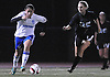 Nassau Team No. 23 Diana Lemus (Uniondale HS), left, gets pressured by Suffolk Team No. 1 Catherine Nolan (Center Morches HS) during the first of two Long Island varsity girls' soccer senior all-star games at Bethpage High School on Friday, November 27, 2015.<br /> <br /> James Escher