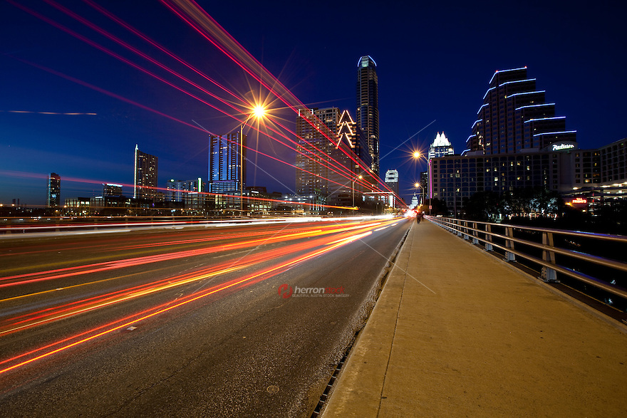 Congress Ave. Bridge at night with intense speed car light trails in Austin, Texas