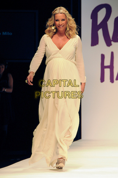 DENISE VAN OUTEN.The Fashion For Relief Haiti 2010 show for London Fashion Week Autumn/Winter 2010 at Somerset House, London, England..February 18th, 2010.LFW catwalk runway full length white cream maxi dress pregnant .CAP/CAS.©Bob Cass/Capital Pictures.