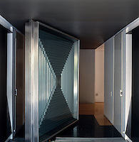 The dramatic pivoting steel entrance door to the Casa En El Aire