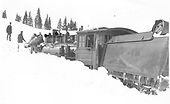 Locomotive in snow with tender derailed.<br /> D&amp;RG    Taken by Lively, Charles R.