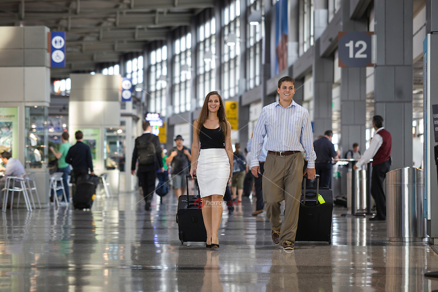 View of young male and female couple walking through Austin ABIA airport terminal.