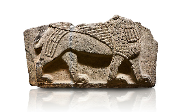 Hittite monumental relief sculpted orthostat stone panel from Water Gate Basalt, Karkamıs, (Kargamıs), Carchemish (Karkemish), 900-700 B.C. Anatolian Civilisations Museum, Ankara, Turkey.<br /> <br />  A portion of the body and the feet of the Sphinx. Its chest was processed as fish flakes. Parallel lines on its wings draw attention.  <br /> <br /> On a white background.