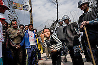 Nepali policeforces watch as maoists celebrate their victory. April 10th 2008 the historic Consistuent assembly elections took place in Nepal, putting an end to a centuries of monarchy. The assembly will form a new constitution and abolish the monarchy and King Gyanendras rule. The big question remains if the new maoist led government will be a positive or a negative factor in a country that recently emerged from a decade of civilwar. Photo: Christopher Olssøn.