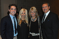 NWA Democrat Gazette/JOCELYN MURPHY<br /> &quot;The Voice&quot; alum Trey O'Dell (from left) and Raka' Pinkerton visit with Vickie and Marty Burlsworth at the seventh annual Brandon Burlsworth Legends Dinner, hosted at the Fort Smith Convention Center on Friday, Oct. 20, 2016.