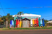 A collection of surfboards line the outside gate of Rainbow Surf Shack (a hostel that may be closed now) on Baldwin Avenue in the eclectic surf town of Pa'ia, Maui.