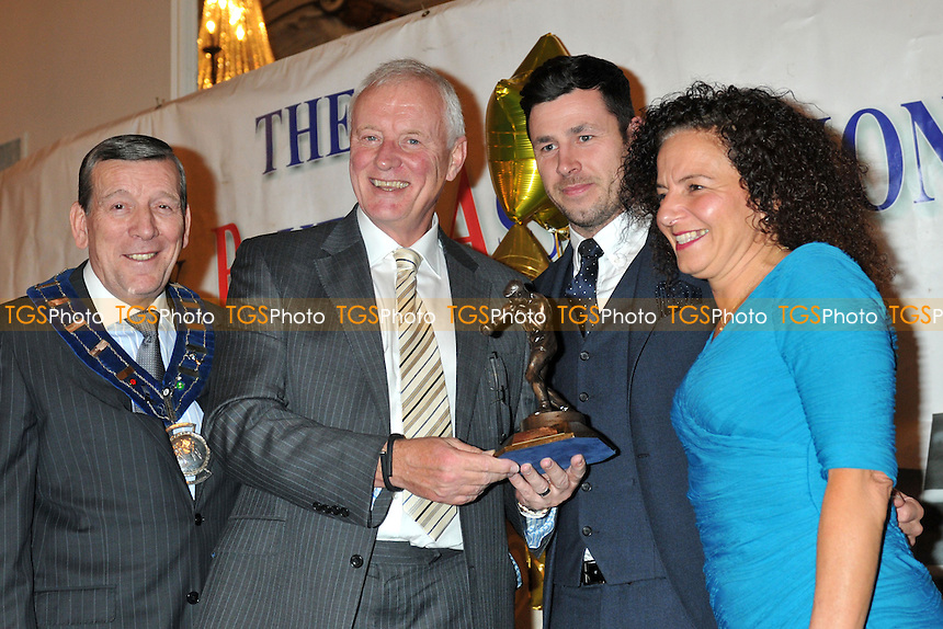 Barry Hearn (2nd L) receives the Dennie Mancini Award for services to boxing from Gina Mancini (R), Darren Barker and Stephen Powell (L) at the London Ex-Boxers Association Awards Dinner- 15/02/14 - MANDATORY CREDIT: Philip Sharkey/TGSPHOTO - Self billing applies where appropriate - 0845 094 6026 - contact@tgsphoto.co.uk - NO UNPAID USE