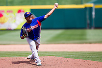 Carlos Hernandez (11) of the Midland RockHounds throws a pitch during a game against the Springfield Cardinals on April 19, 2011 at Hammons Field in Springfield, Missouri.  Photo By David Welker/Four Seam Images