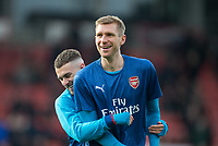 Aaron Ramsey & Per Mertesacker of Arsenal ahead of the Premier League match between Bournemouth and Arsenal at the Goldsands Stadium, Bournemouth, England on 14 January 2018. Photo by Andy Rowland.