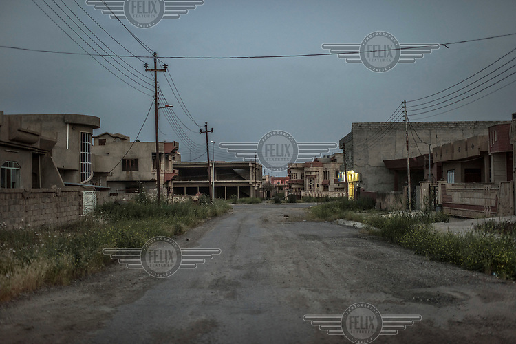 A deserted street in Qaraqosh, a town with a majority Christian population which was overrun by ISIS militants in 2014. Although since retaken, almost none of the town's residents have returned.